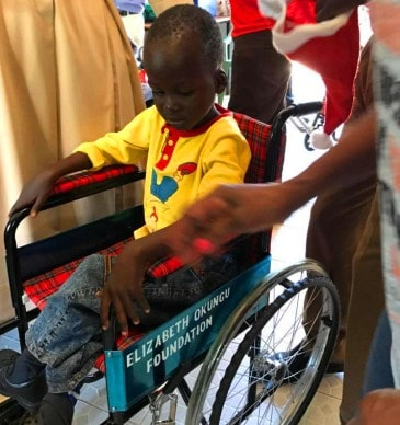 A child learns what a wheelchair is.
